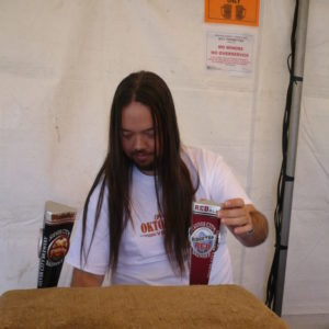 Guy pouring beer at Fremont Oktoberfest