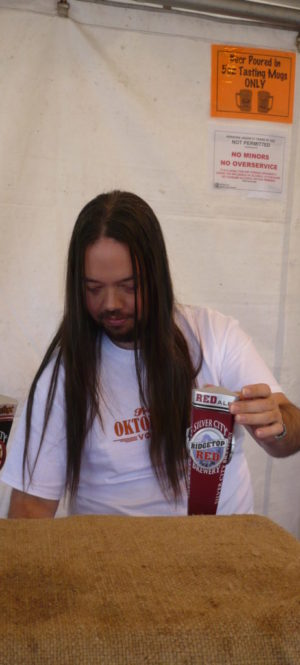 Guy pouring beer at Fremont Oktoberfest